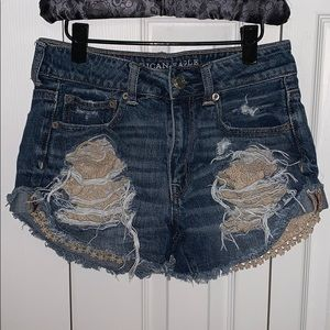 AE ripped high wasted jean shorts.